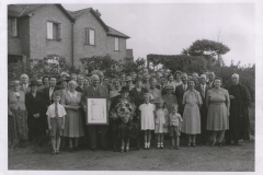 Presentation to-Mrs Winsmore-Hooper taken outside Village Hall